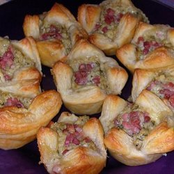 Baked Brie Pastries With Artichoke and Prosciutto recipe