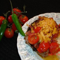 Zesty Chops With Onions and Cheese recipe