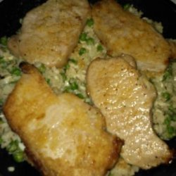 Pork Chops over Parmesan Rice With Peas recipe