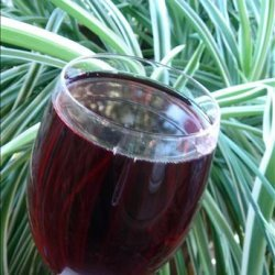 Champagne With Pomegranate Syrup and Raspberries recipe