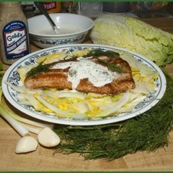 Salmon With a Creamy Sauce on a Bed of Greens recipe