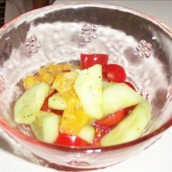 Orange Tomato Cucumber Salad With Orange and Maple Dressing recipe