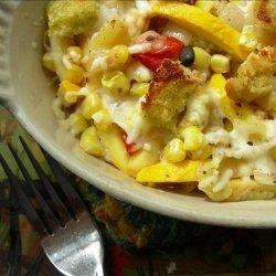 Cheesy Zucchini and Corn  With Pesto Bread Topping recipe