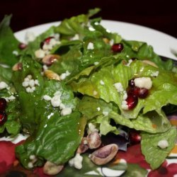 Spring Mix Salad With Pomegranate, Honey Dressing and Toasted P recipe