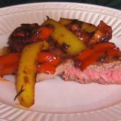 Steak Topped With Peppers and Onions recipe