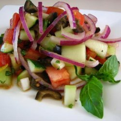 Cucumber Tomato Salad With Zucchini and Black Olives and a Lemon recipe