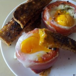 Eggs Baked in Tomatoes With Prosciutto & Basil recipe