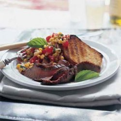 Flank Steak With Corn-Tomato Relish and Grilled Garlic Bread recipe