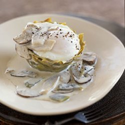 Poached Eggs on Artichoke Bottoms with White Truffle Cream and Mushrooms recipe