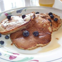 Banana Pecan Pancakes Served With Berries