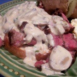 Steak Served on Parmesan Toasts With Sour Cream/Onion/Garlic Sau
