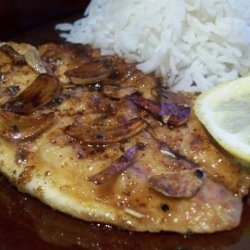 Sauted Fish Fillets With Sliced Garlic and Butter Sauce