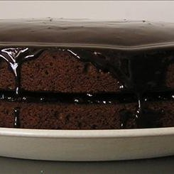 Chocolate  Cake Dripping With Chocolate Sauce