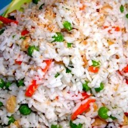 Coconut Rice Erupting With Spices, Nuts & Peas
