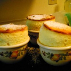 Coconut and White Chocolate Souffles With Mango-Rum Sauce