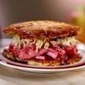 Latke Corned Beef Sandwich with Apple and Sour Cream Slaw (Jeff Mauro)
