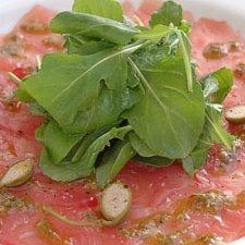 Tuna Carpacio With Basil Oil Lemon And Caper Berri...