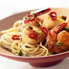 Shrimp And Scallops In Thai Green Curry Sauce Over...