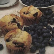 Pineapple-blueberry Muffins With Cream Cheese Fill...