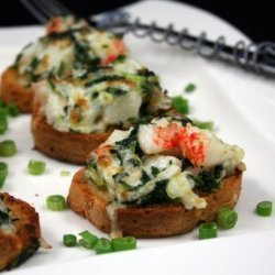 Garlic Bread Topped With Crab Meat and Spinach